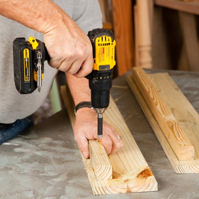 Tom Silva attaching a cleat to a side board with a drill/driver