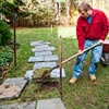 stripping out sod for place of paver in stone stepping path 