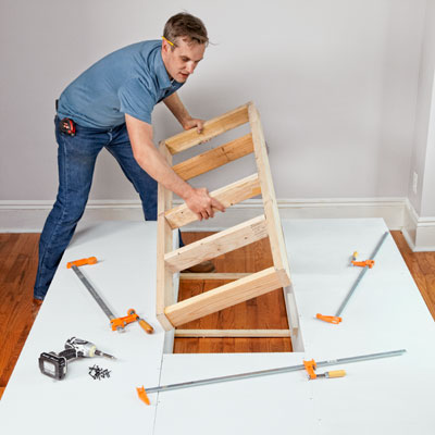 installing the 2x4 support frame for a storage bed