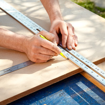marking and cutting MDF for the bed frame of a storage bed