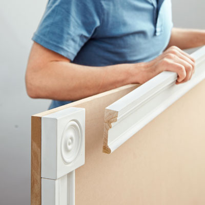 attaching the headboard trim for a storage bed