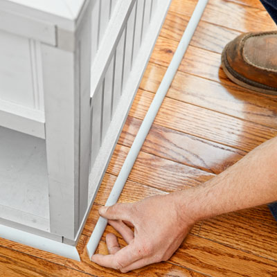 installing the shoe molding for a storage bed