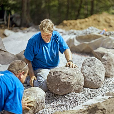 placing first stones for building a fieldstone wall