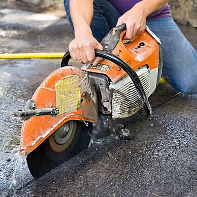 cutting a driveway with a concrete saw