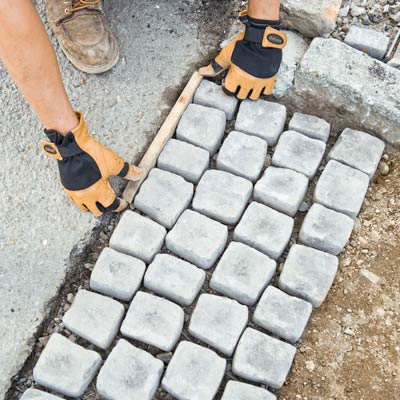 Begin Laying The Cobblestone Mats How To Build A