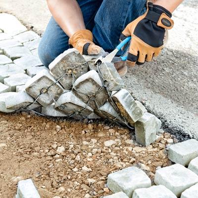 interlacing the cobblestone mats in the driveway apron