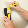 finding and marking a stud in the wall with a stud finder