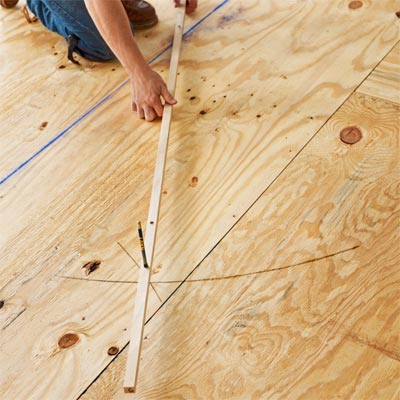 finding a center line with a trammel to install a herringbone floor