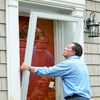 putting storm door in place to install a storm door