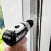 fastening the rails to install a storm door