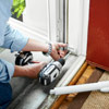 attaching the brackets to install a storm door