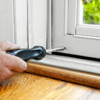 adjust the door sweep to install a storm door