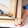 attaching reinforcing block to an outside miter for kitchen cabinet crown molding