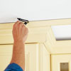 scribing the gap between a kitchen cabinet with crown molding and the ceiling