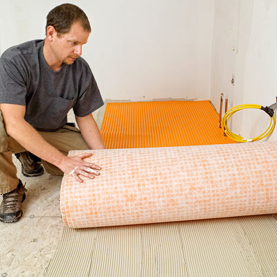 how to lay a stone-tile floor roll out the membrane