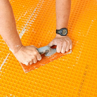 how to lay a stone-tile floor secure the membrane