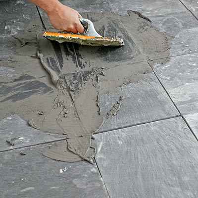 how to lay a stone-tile floor grout the joints