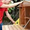 Make the Door by Installing the Hardware when Building a Fold-Down Murphy Bar