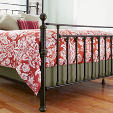 bed with box spring covered in fabric for upholstered look