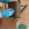 give a watering can a faux rust coating apply rust solution over tacky paint