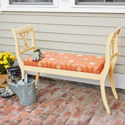 a garden bench made from 2 harp-backed dining room chairs