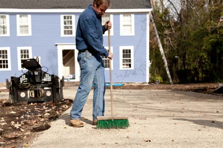 roger cook sweeping stone for a low-maintenance, all-gravel driveway