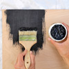reader painting plywood backing with black paint for stacked log imitation summer front for fireplace