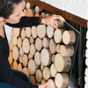 reader installing stacked log imitation summer front for fireplace