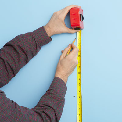 marking shelf areas with a tape measure