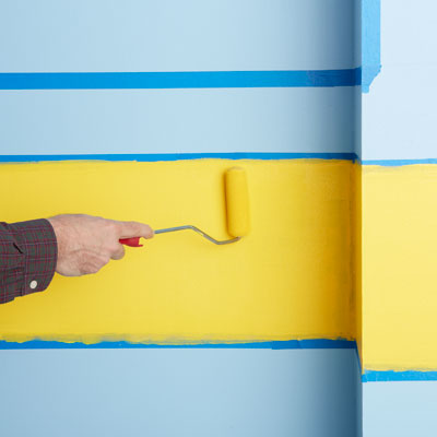 painting the yellow area with a dense foam roller