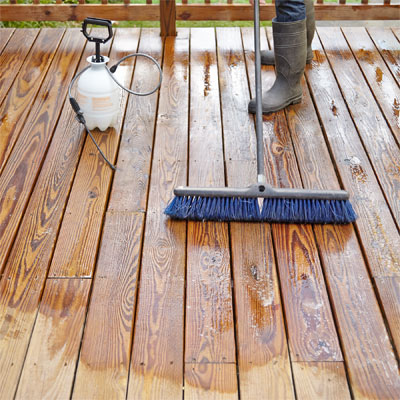 Wash the deck revive a beat up deck this old house for Revive deck cleaner
