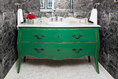 a dresser re-purposed as a vanity