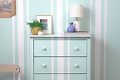 coordinated stripes on both wall and dresser