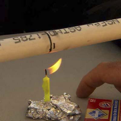 lit birthday candle heats up piece of PVC