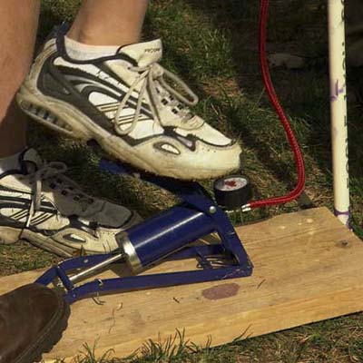 foot operated bicycle pump with pressure gauge attached