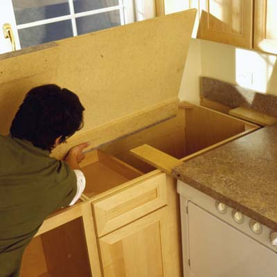Attach the countertop to the cabinet