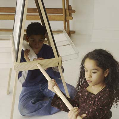 kids sliding paper roll to the easel