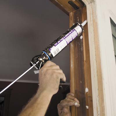 apply caulk to the exposed inner face of the exterior casings or to the blind stops on the top and sides of the frame.