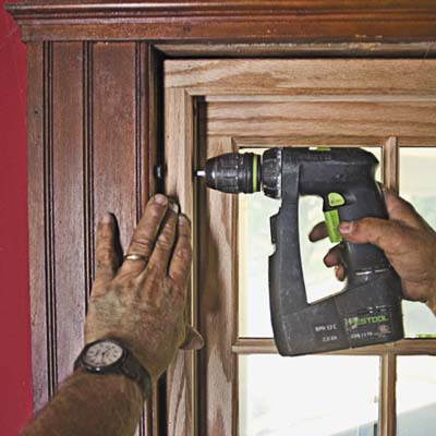 fasten the window loosely with a 2inch screw