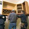 tom silva hanging upper kitchen cabinets with two helpers