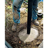 Setting the post into the concrete footing