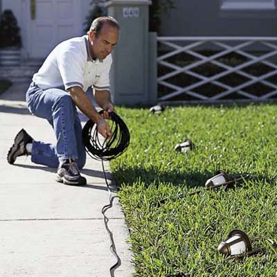 laying out the components of landscape lighting
