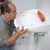 Richard Trethewey mounting a pedestal sink