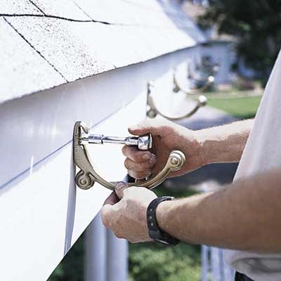 attaching fascia brackets for a gutter installation