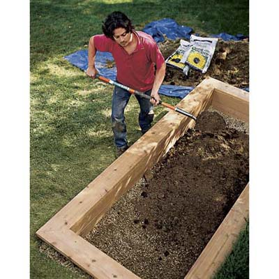 Filling the bed with soil.