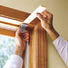 inserting a thin wood shim when installing a window shade