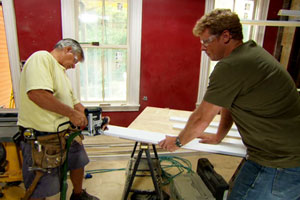 Tom Silva shows Kevin O'Connor how to convert a former doorjamb into a cased opening