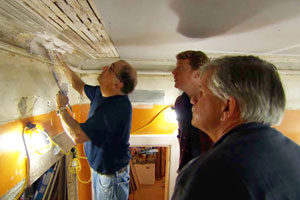 Bob Bucco repairs damaged plaster mouldings with Kevin O'Connor and Tom Silva looking on