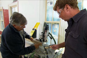 Tom Silva shows Kevin O'Connor how he's using stock trim profiles for the door and window casings