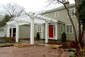 the Auburndale house exterior during renovation, finished pergola